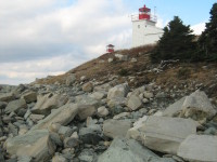 Click to explore our site! Port Bickerton Lighthouse:  Upon The Rocks